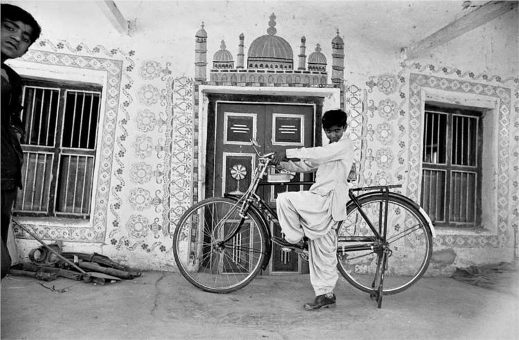 A boy with a bicycle in Dhordo, Gujarat - Jyoti Bhatt